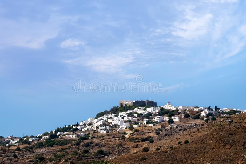 The chora of Patmos island, Dodecanese, Greece, under a warm evening sky. The chora of Patmos island, Greece, under a warm evening sky royalty free stock photography