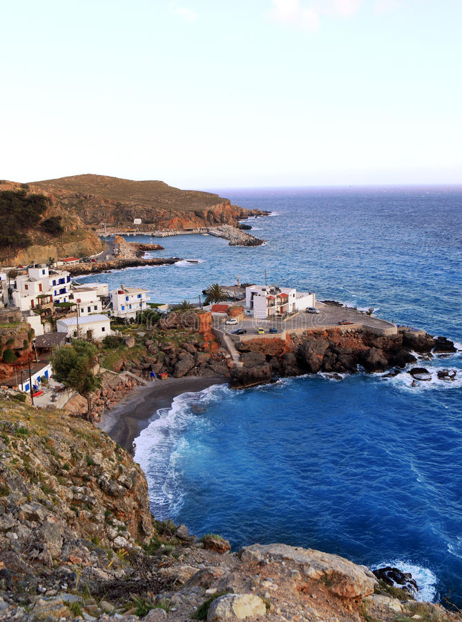 Chora sfakion from the west. A view of Chora Sfakion town in south crete, seen from the West at sunset royalty free stock image