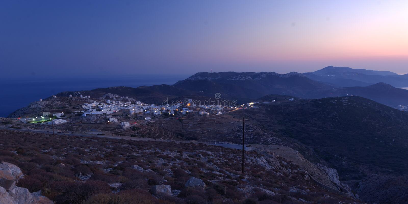Chora village on Amorgos island. Panoramic view of Chora village on Amorgos island viewed at sunset royalty free stock photo