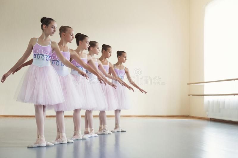 Choreographed dance by group of young ballerinas royalty free stock photos