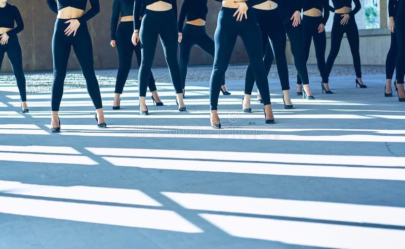 Choreography of girls dancing with black mayas and heels royalty free stock photos