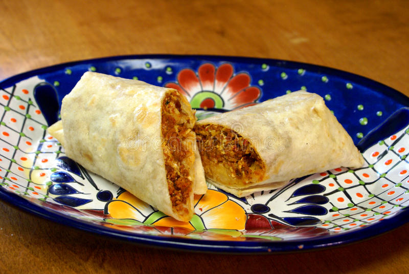 Chorizo Breakfast Burrito. Chorizo (pork sausage), egg and cheese breakfast burrito with flour tortilla stock image