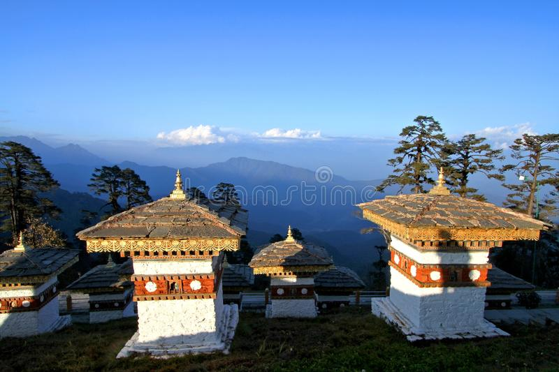 The 108 chortens stupas is the memorial in honour of the Bhutan. Ese soldiers with layer of mountains at Dochula Pass on the road from Thimphu to Punaka, Bhutan royalty free stock photography