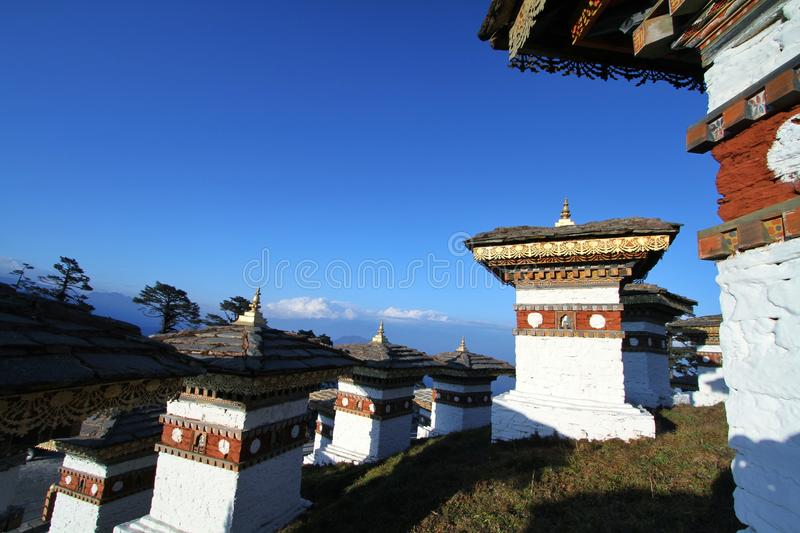 The 108 chortens stupas, the memorial in honour of the Bhutan. The 108 chortens stupas is the memorial in honour of the Bhutanese soldiers with layer of royalty free stock photo