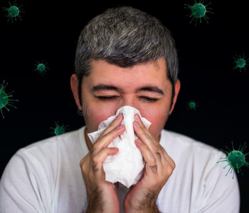 Chory człowiek dmuchający nos, wirusy wokół zdjęcie stock