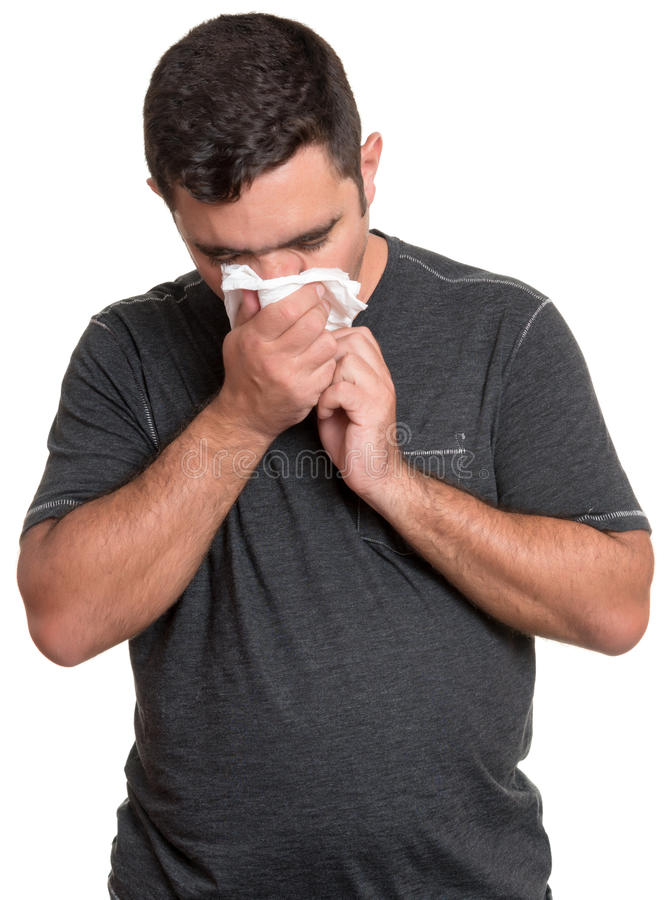 Chory mężczyzna dmucha jego nos odizolowywający na bielu zdjęcie stock