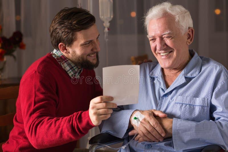 Chory ojciec i syn obrazy stock