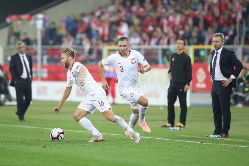 CHORZOW, POLEN - OKTOBER 11, 2018: UEFA-Natiesliga 2019: Polen - Portugal o/p Jakub Blaszczykowski, Artur Jedrzejczyk, Jerzy royalty-vrije stock fotografie