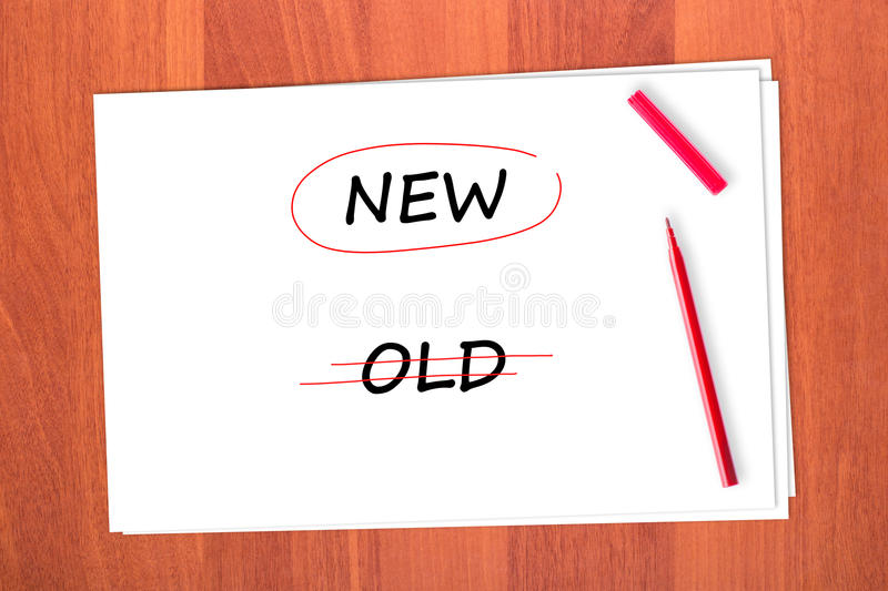 Chose the word NEW. Crossed out the word OLD royalty free stock images