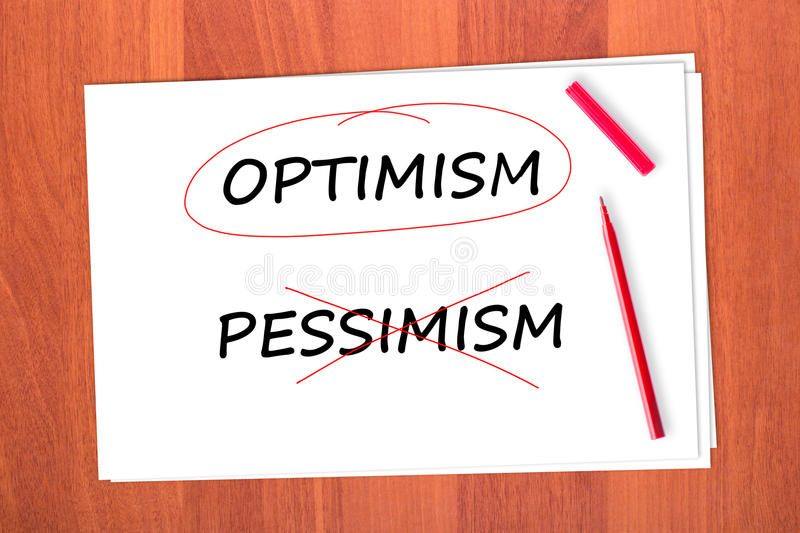 Chose the word OPTIMISM. Crossed out the word PESSIMISM stock photos