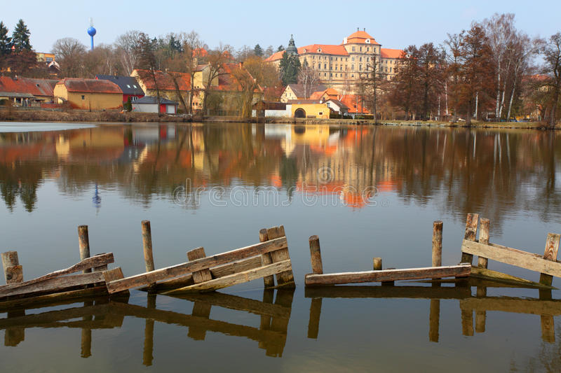Chotesov monastery over a pond. royalty free stock images