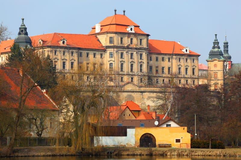 Chotesov monastery over a pond. stock photography