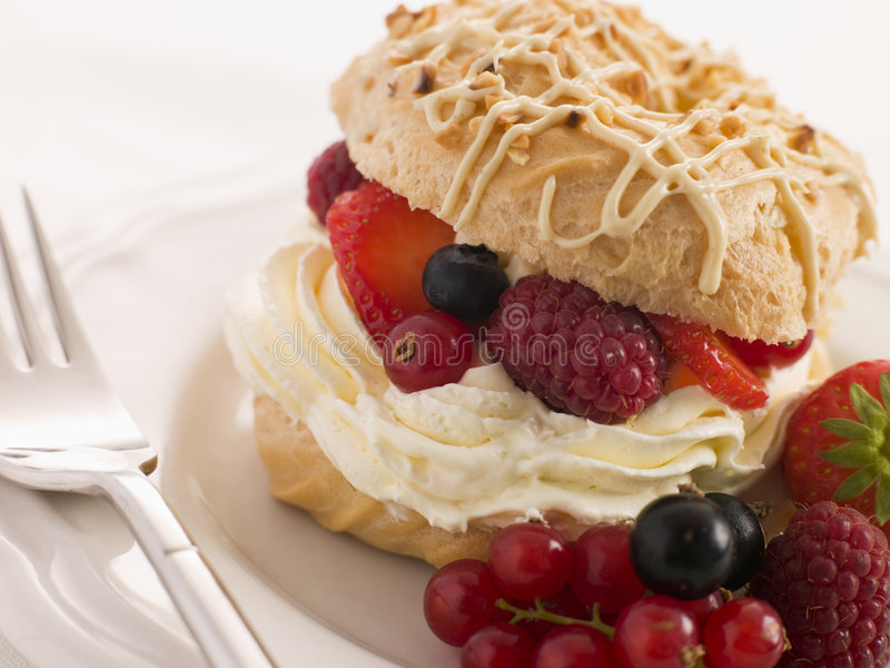 Choux Bun filled with Mixed Berries cream stock image