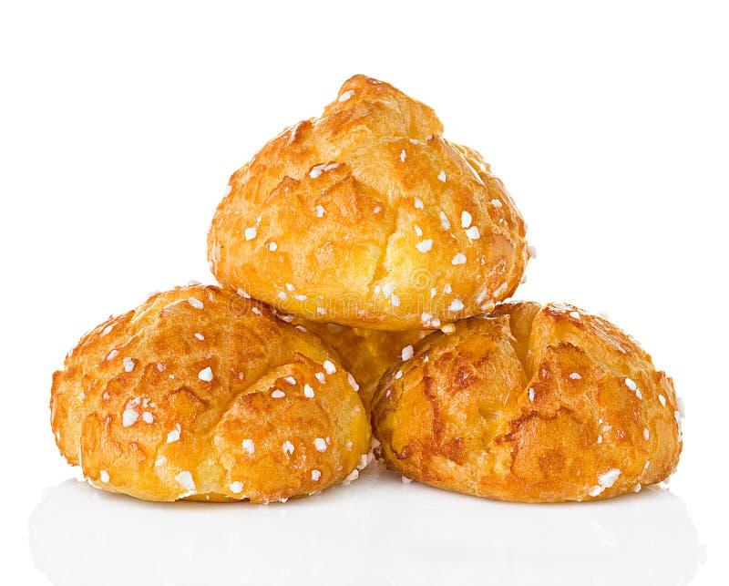 Choux pastelaria, eclairs isolados no branco foto de stock