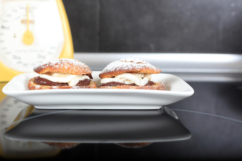 Download Choux Pastry With Vanilla And Chocolate Cream Stock Photo - Image: 26596832