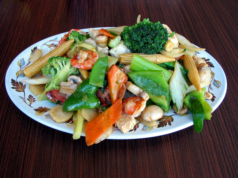 Chow mein. Generious portion of chow mein served on a plate royalty free stock images