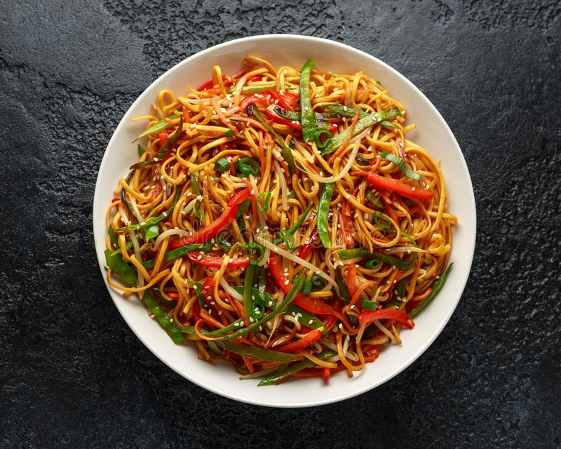 Chow mein noodle dish with vegetables. red pepper, carrot, mangetout and bean sprouts.  royalty free stock images