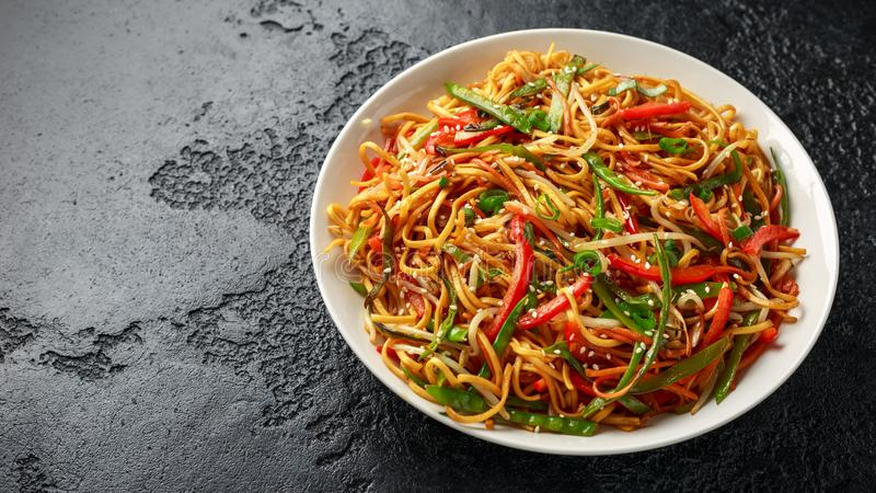 Chow mein noodle dish with vegetables. red pepper, carrot, mangetout and bean sprouts.  royalty free stock photos