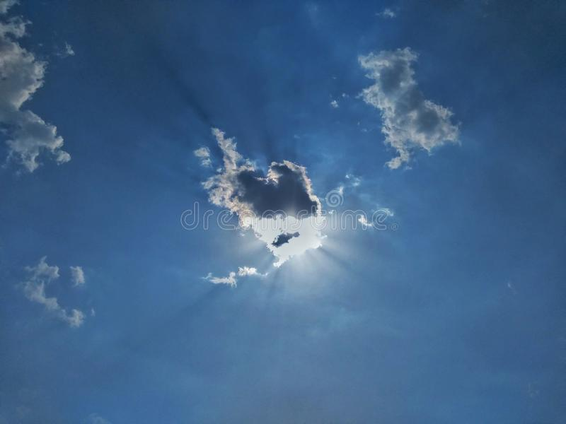Chowany słońce i chmura zdjęcie royalty free