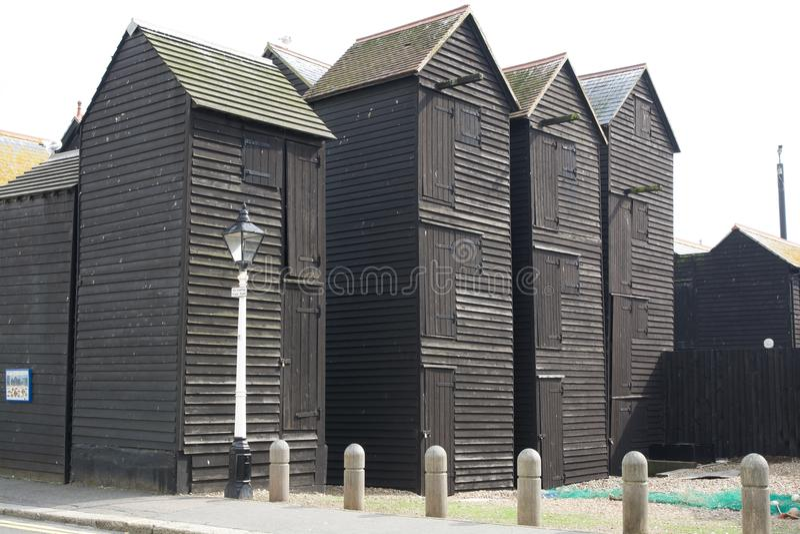 Chozas de madera negras del pescador en Hastings, Inglaterra imagen de archivo