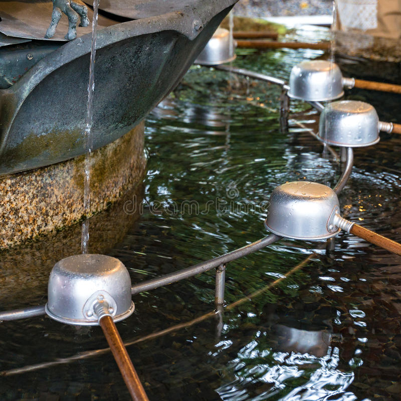 Chozuya purification fountain. Japanese culture. Chozuya purification fountain ladles. Traditional Japanese Shinto washbasing for ritual cleansing of worshippers royalty free stock image
