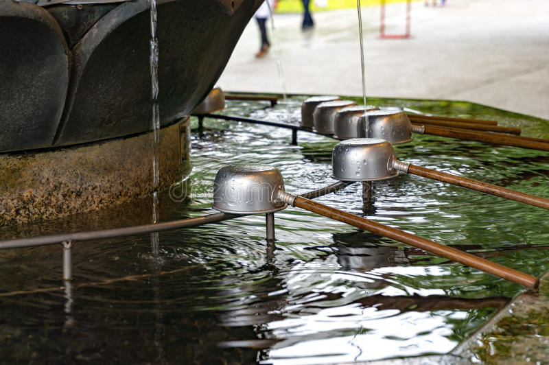 Chozuya purification fountain. Japanese Shinto shrine. Chozuya purification fountain ladles. Traditional Japanese Shinto washbasing for ritual cleansing of stock photography