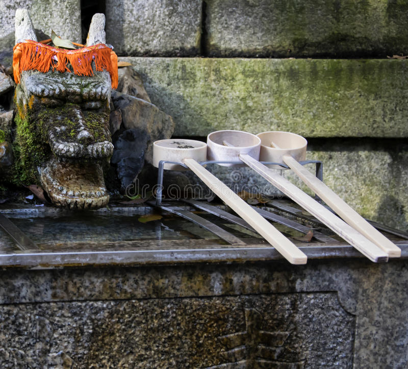 Chozuya purification fountain ladles. Traditional Japanese Shinto wash basin for ritual cleaningof worshipers. At the shrine entrance royalty free stock photo