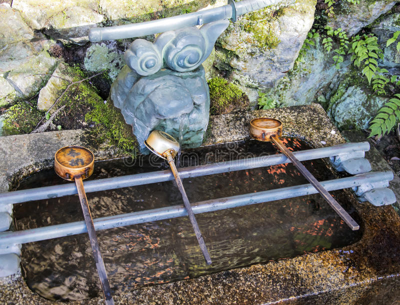 Chozuya purification fountain ladles. Traditional Japanese Shinto wash basin for ritual cleaningof worshipers. At the shrine entrance stock photography