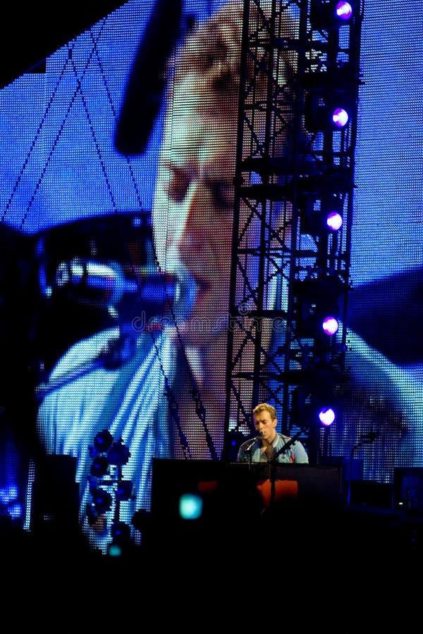 Chris Martin playing piano royalty free stock photo