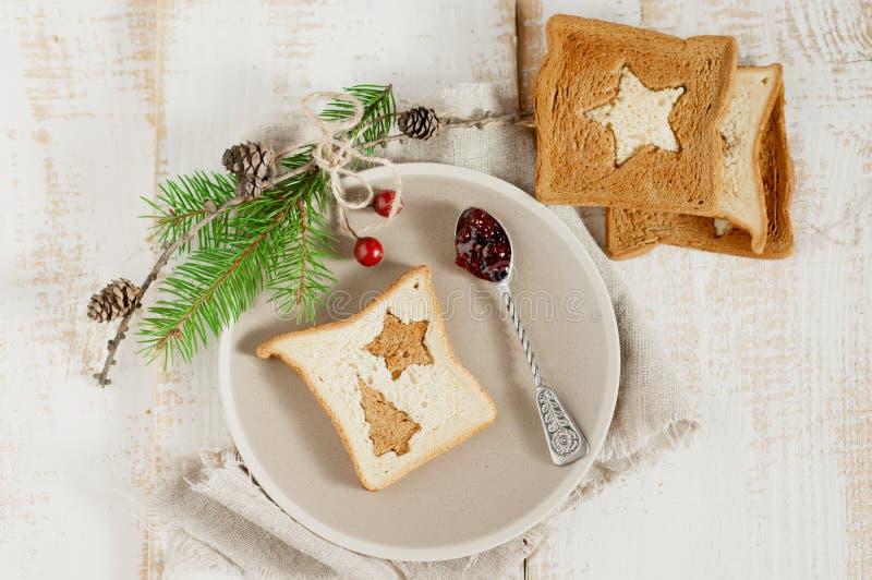 Chrismas breakfast. Spoon berry jam and slice toast bread. Chrismas breakfast. Spoon berry jam and slice toast bread on wooden boards stock photos