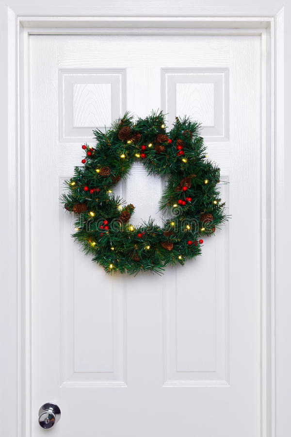 Download Chrismas Wreath On A White Door Royalty Free Stock Image - Image: 22260176