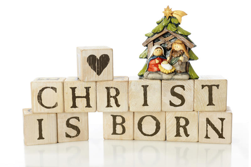 Christ Is Born. Rustic alphabet blocks arranged to say, Crhist is born. They're topped with a heart-block and a small nativity scene with Mary, Joseph and baby royalty free stock photography