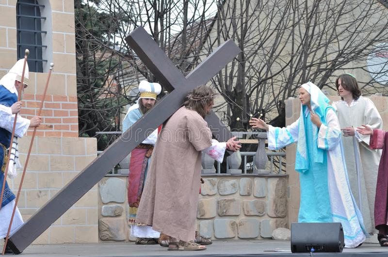 Christ Carrying the Cross. Jesus meets His Mother on the way to crucifixion, during the street performances Mystery of the Passion on April 17, 2011 in Gora stock photo