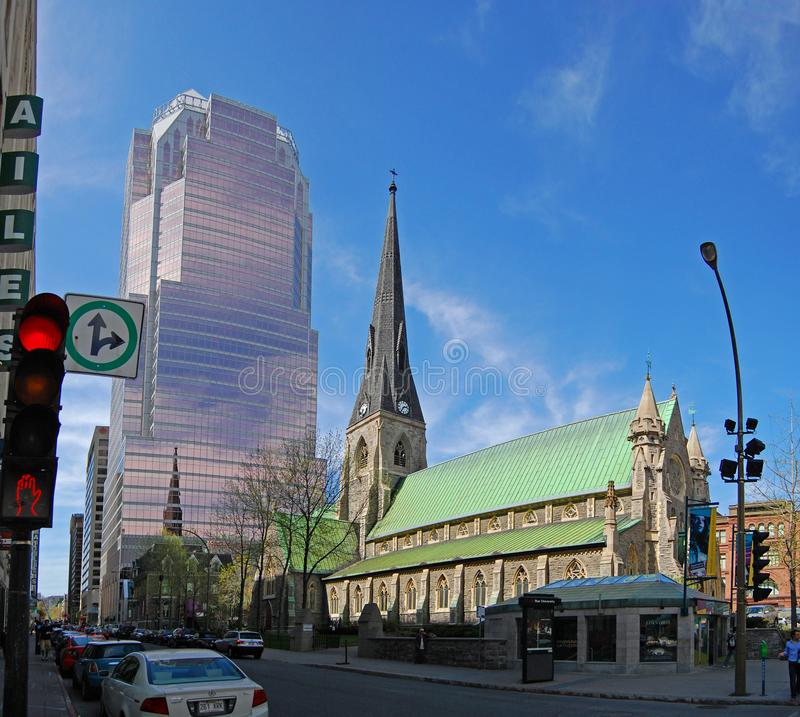 Christ Church Cathedral, Montreal, Canada. Christ Church Cathedral with the Tour KPMG office tower in the background on Saint Catherine Street in Montreal royalty free stock photos