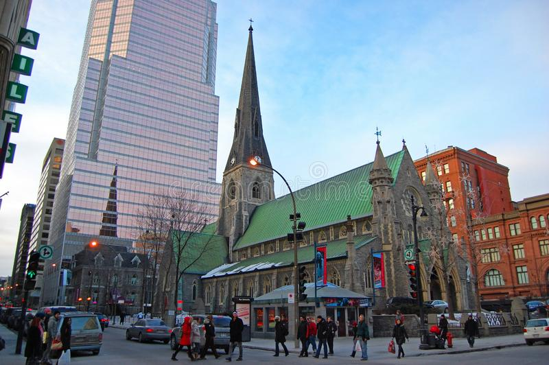 Christ Church Cathedral, Montreal, Canada. Christ Church Cathedral with the Tour KPMG office tower in the background on Saint Catherine Street in Montreal royalty free stock photo