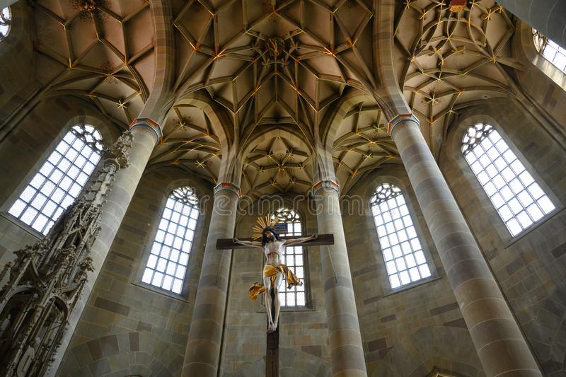 Christ Crucified and vertical view to Gothic chor vault of Saint Michaels Church, Schwabisch Hall, Baden-Wurttemberg, Germany. Jesus on Cross with view to royalty free stock photos