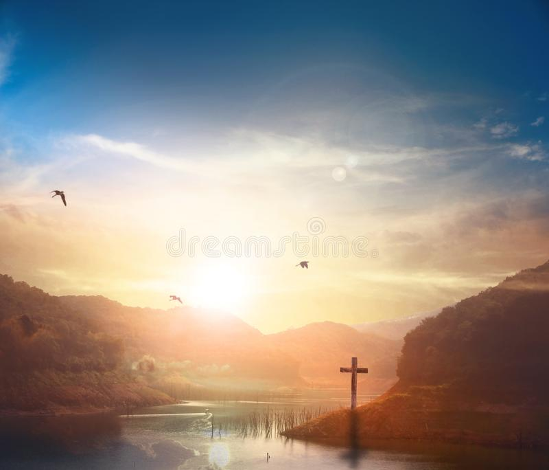 Christ Jesus birth and resurrection concept :Silhouette cross on Calvary mountain sunset background. Christian concept background:Eucharist Therapy Bless God royalty free stock image