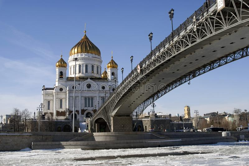 Christ Redeemer cathedral in Moscow. Color winter photo. No people. The Moscow river embankment, frozen water of Moscow river. Patriarshy bridge royalty free stock image