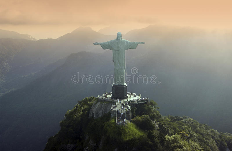 Christ the Redeemer - Rio De Janeiro - Brazil. The statue of Christ the Redeemer at Corcovado in Rio De Janeiro in Brazil - South America. An Art Deco statue of royalty free stock image