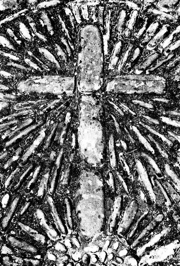 Christelijk dwarsmetselwerkdetail van een oud keivierkant royalty-vrije stock foto's