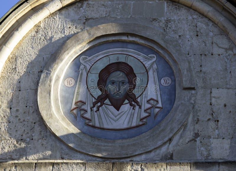 Christelijke fresko op de muur stock foto