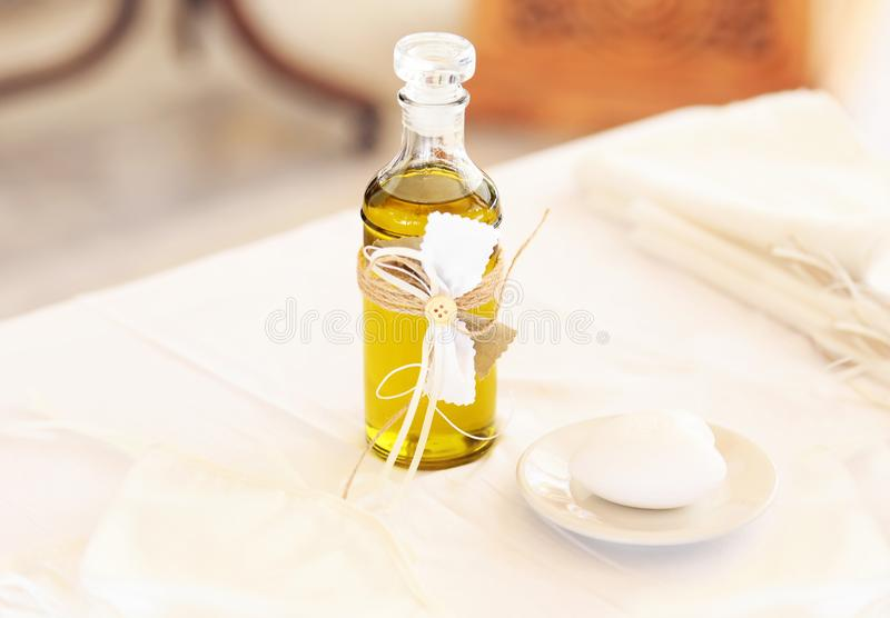 Christening decoration with baptism oil, candles and soap stock image