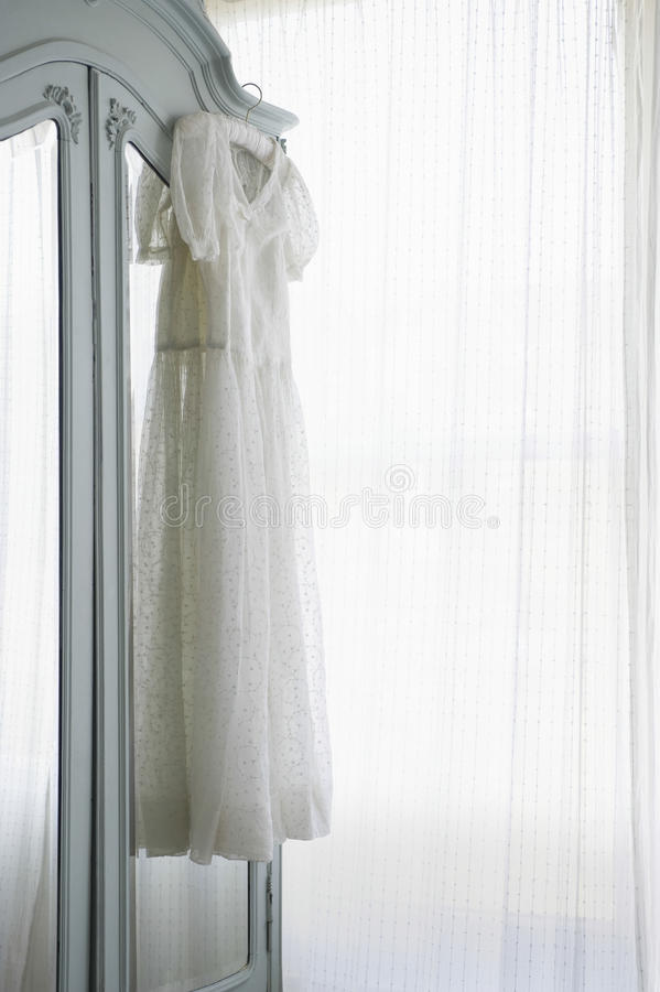 Christening Gown On Wardrobe stock photos