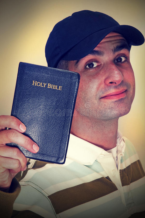 Christian. Cross-Processed photo of a Christian holding his Holy Bible royalty free stock photos