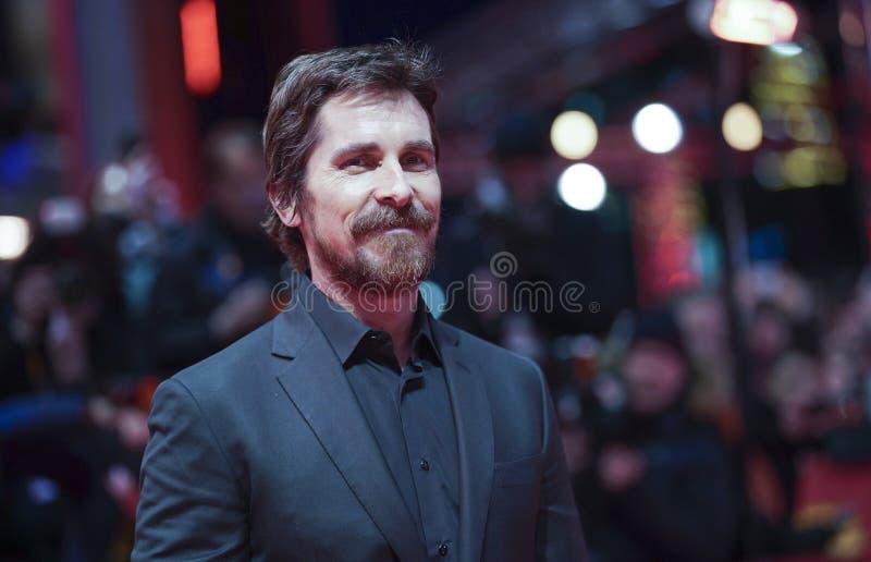 Christian Bale poserar på 'det vice royaltyfria bilder