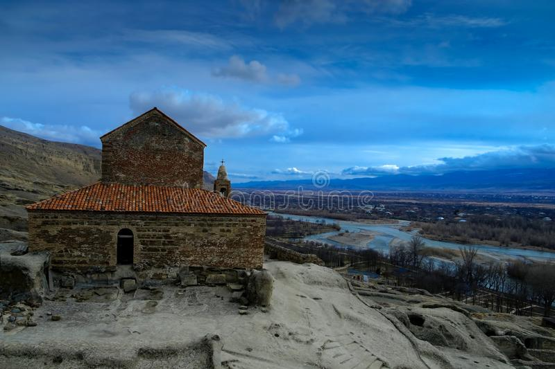 Christian Basilica in ancient rock-hewn town called Uplistsikhe royalty free stock photos