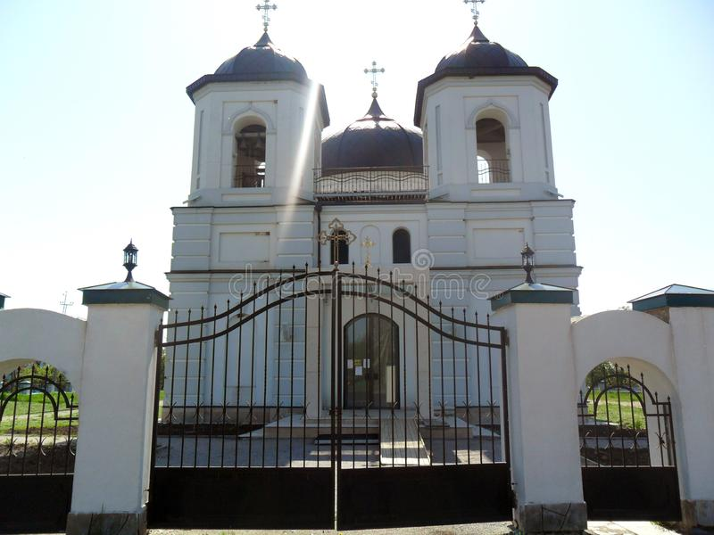 Christian church with close fence stock image