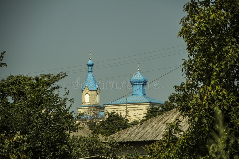 Christian church domes. Far away are the blue domes of the Christian church. In the sunlight, they shimmer royalty free stock photography