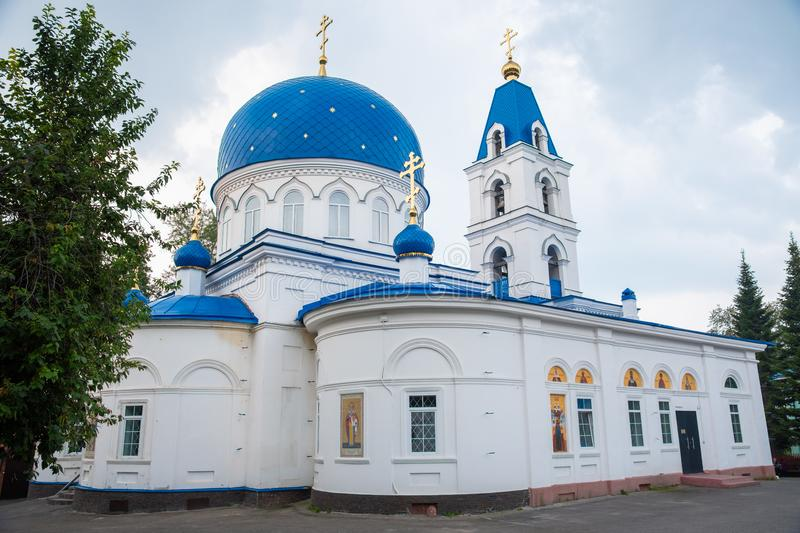 Christian Church of white stone with blue domes with stars and gold crosses. royalty free stock photography