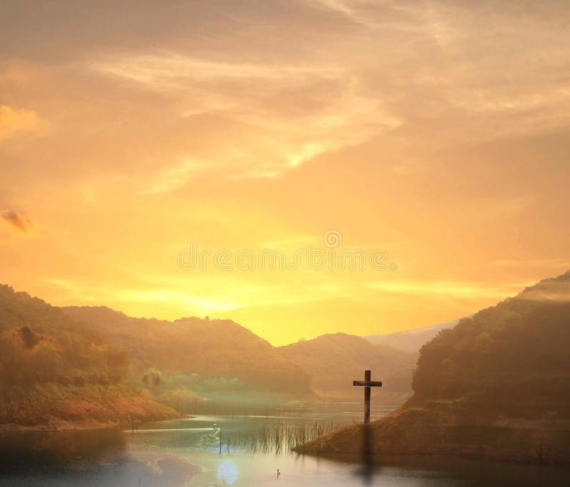 Silhouette cross on Calvary mountain sunset background. Easter concept stock photography